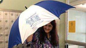 Renter holding umbrella